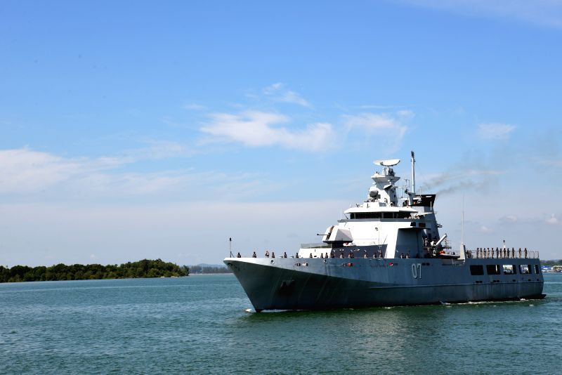 A Royal Brunei Navy vessel departs for China's Qingdao to join a maritime exercise in Muara Port, Brunei, April 14, 2014. A total crew of 69 Royal Brunei Navy ..