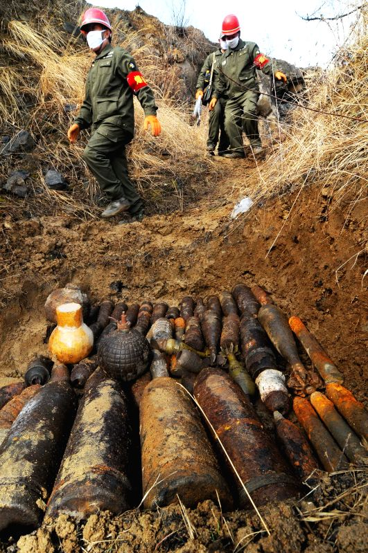 Staff members prepare to destroy Japanese weapons in Mudanjiang City, northeast China's Heilongjiang Province, April 10, 2015. A total of 475 non-chemical ...