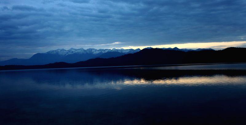 Photo taken on May 7, 2014 shows a magnificient morning view of Rara lake with Himalayan ranges at the background in Mugu, Karnali, Nepal. Rara lake, the biggest lake of