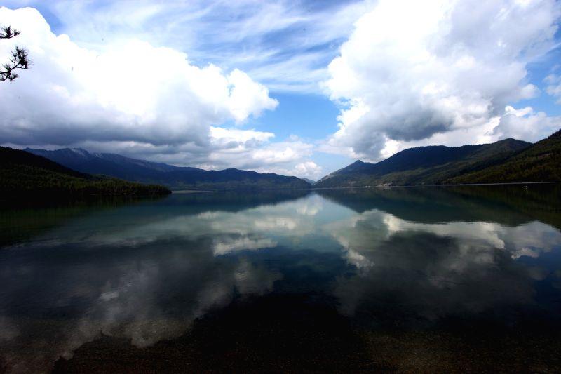 Photo: Photo taken on May 7, 2014 shows a magnificent morning view of Rara lake with Himalayan ranges at the background in Mugu, Karnali, Nepal. Rara lake, the biggest ..