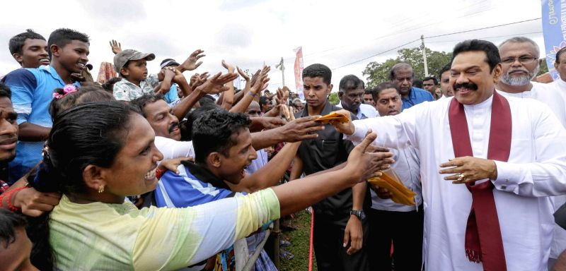 Sri Lankan President Mahinda Rajapaksa (front R) greets his supporters during an election rally in Mullaitivu, northern Sri Lanka, on Dec. 18, 2014. Sri