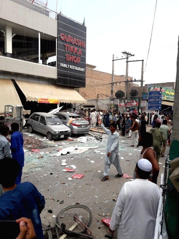 MULTAN, July 16, 2018 - People gather at the blast site in central Pakistan's Multan on July 16, 2018. At least three people were killed and 25 others injured when a blast hit a restaurant in ...