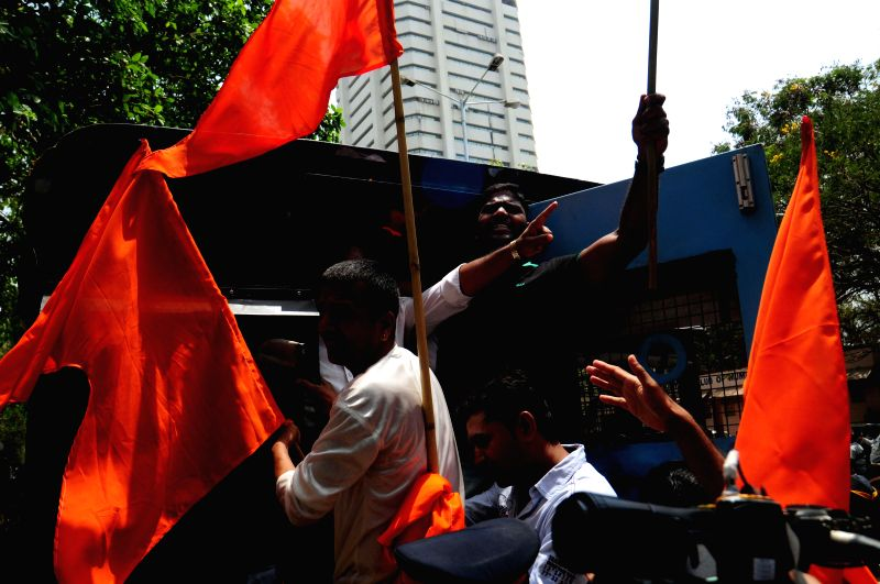 Shiv Sena activists staged a protest outside the house of author Shobhaa De over her controversial remarks in Mumbai on April 9, 2015.