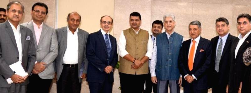 A CII delegation led by the Chairman of Godrej Group Adi Godrej meets Maharashtra Chief Minister Devendra Fadnavis in Mumbai, on Nov 19, 2014. The delegation comprised of Executive Vice ... - Devendra Fadnavis, Ashwini Malhotra and Arup Basu