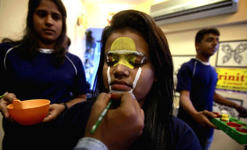 A cricket fan gets her face painted ahead of ICC World Cup 2015 in Mumbai, on Feb 11, 2015.