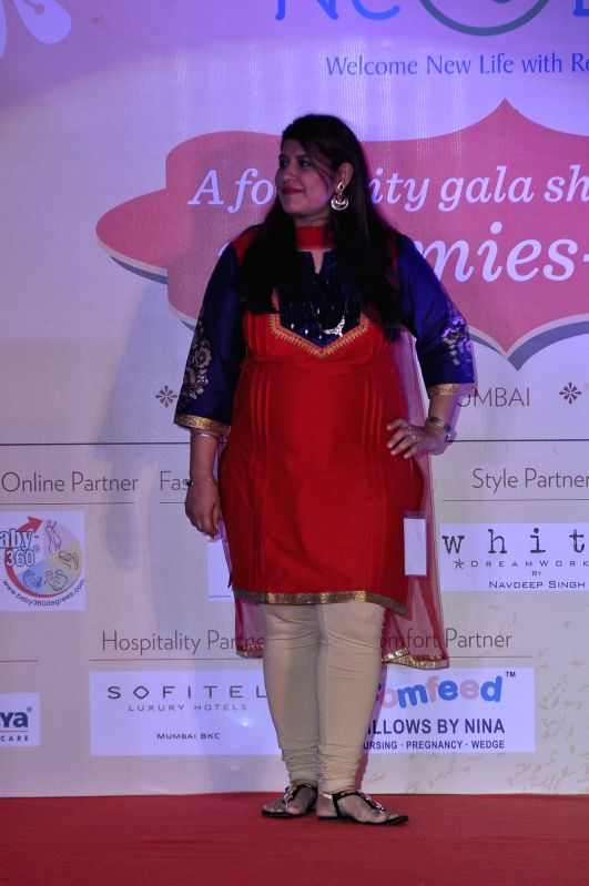 A expecting mother walks the ramp during a expecting mothers fashion show organised by Cordlife in Mumbai on March 15, 2015.