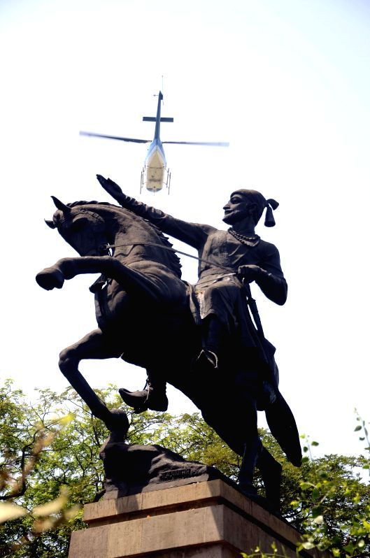 A helicopter showers flower petals over the statue of Shivaji during a programme organised on his (Hindu calendar) birth anniversary by Maharashtra Navnirman Sena at Shivaji Park in Mumbai, ...