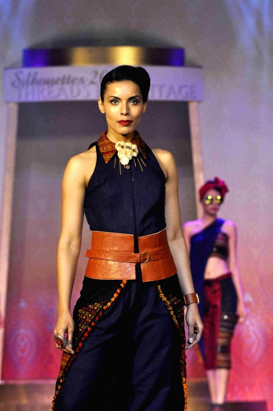 A model walks on the ramp during the Silhouettes 2015, annual fashions show of B D Somani institute Art & Fashion, in Mumbai, on May 3, 2015.