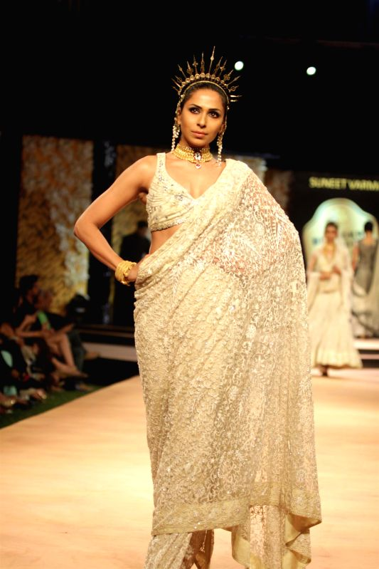 A model walks on the ramp for designer Suneet Varma`s show at Blenders Pride Fashion Tour 2014 in Mumbai on Saturday, November 29, 2014.