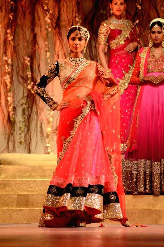 A Model walks the ramp for outfit by fashion designer Vikram Phadnis during the Renaissance's Wedding Fair 2015 in Mumbai on 5th April 2015.