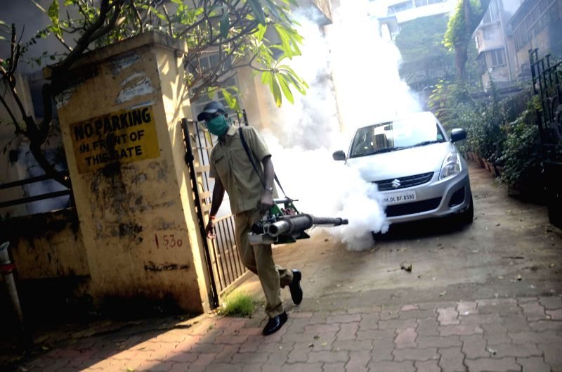 A Municipal Corporation of Greater Mumbai (MCGM) worker carries out fogging in Dadar to control mosquitoes, in Mumbai on Nov 18, 2014.
