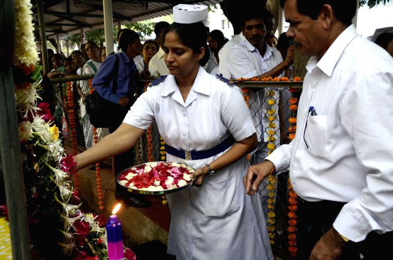 A nurse pays homage to those killed in the 26/11 attacks on Cama Hospital on the 6th Anniversary of the attacks, at Cama Hospital in Mumbai on Nov.26, 2014. Ten heavily armed Pakistani ...