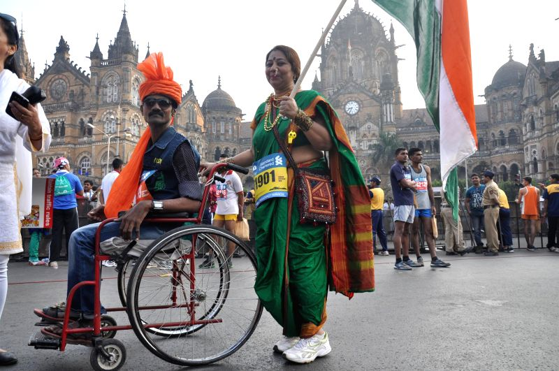 A physically challenged athlete participates in the Standard Chartered Mumbai Marathon 2015 in Mumbai on Jan 18, 2015.