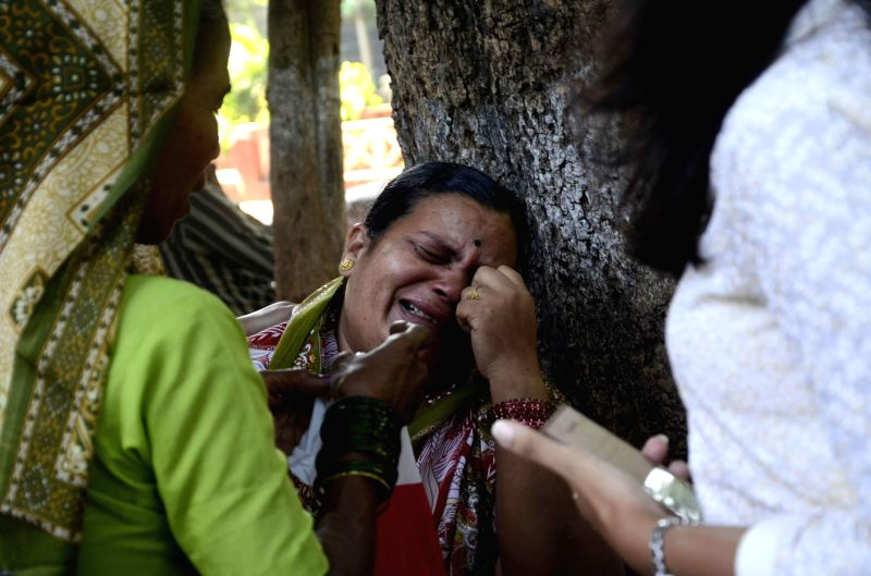 A relative of a victim of 26/11 attacks on Cama Hospital mourns on the 6th Anniversary of the attacks, at Cama Hospital in Mumbai on Nov.26, 2014. Ten heavily armed Pakistani terrorists had ..