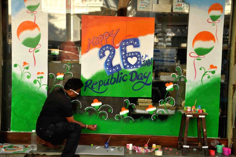 A shopkeeper decorates his shop ahead of Republic Day in Mumbai, on Jan 22, 2015.