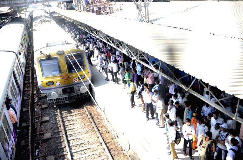 A train chugs into the Dadar Station in Mumbai, on Feb 26, 2015. Union Railways Minister Suresh Prabhakar Prabhu Thursday presented the Railway Budget 2015-16 at the Parliament. - Suresh Prabhakar Prabhu Thursday