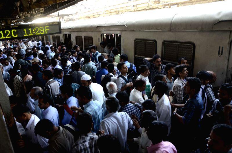 A view of a crowded Dadar Station in Mumbai, on Feb 26, 2015. Union Railways Minister Suresh Prabhakar Prabhu Thursday presented the Railway Budget 2015-16 at the Parliament. - Suresh Prabhakar Prabhu Thursday
