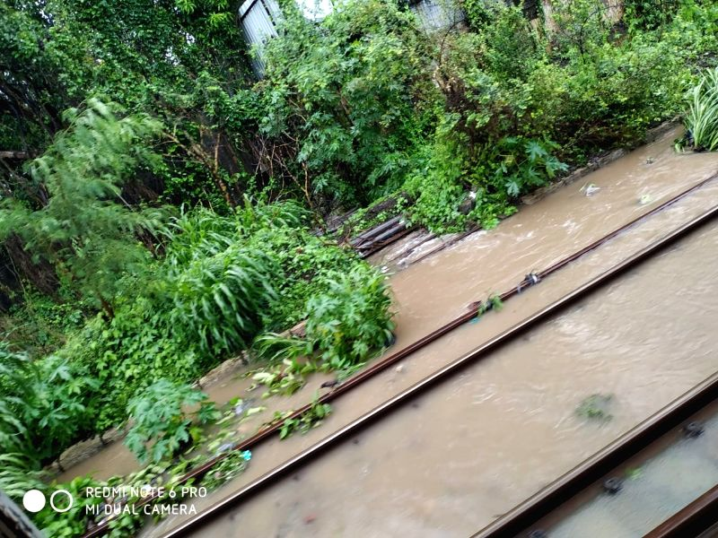 Mumbai: A view of the water-logged railway tracks at the Kanjurmarg station after heavy rains, in Mumbai on June 28, 2019. (Photo: IANS)