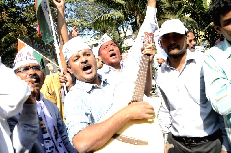 Aam Aadmi Party (AAP) leaders celebrate party's performance in the recently concluded Delhi Assembly Polls in Mumbai, on Feb 10, 2015.