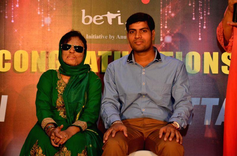 Acid attack survivor Sonali Mukherjee and Chittranjan Tiwari, a Jharkhand based electrical engineer celebrate their marriage in Mumbai on April 24, 2015.