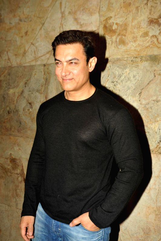Actor Aamir Khan during the special screening film PK, in Mumbai, on December 25, 2014. - Aamir Khan