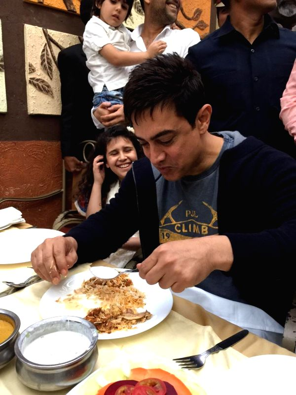 Actor Aamir Khan feasted biryani , in Hyderabad.