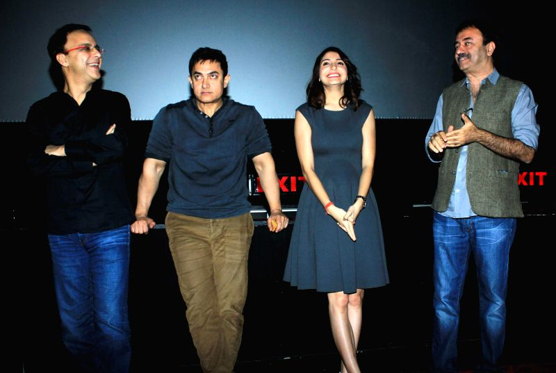Actor Aamir Khan, filmmaker Vidhu Vinod Chopra, actor Anushka Sharma and filmmaker Rajkumar Hirani during special screening of film PK organised for the Mumbai Police officials in Mumbai on .. - Aamir Khan, Vidhu Vinod Chopra and Anushka Sharma