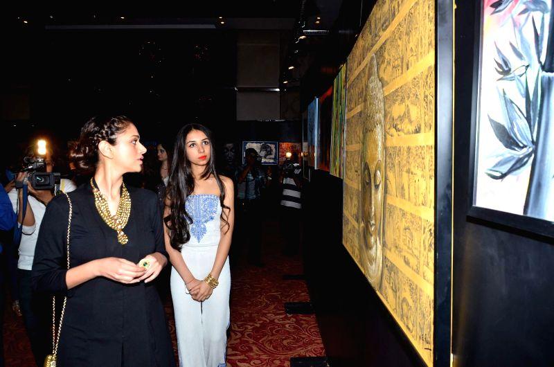 Actor Aditi Rao Hydari attend the charity art auction by Nikhar Tandon in Mumbai, on December 6, 2014. - Aditi Rao Hydari