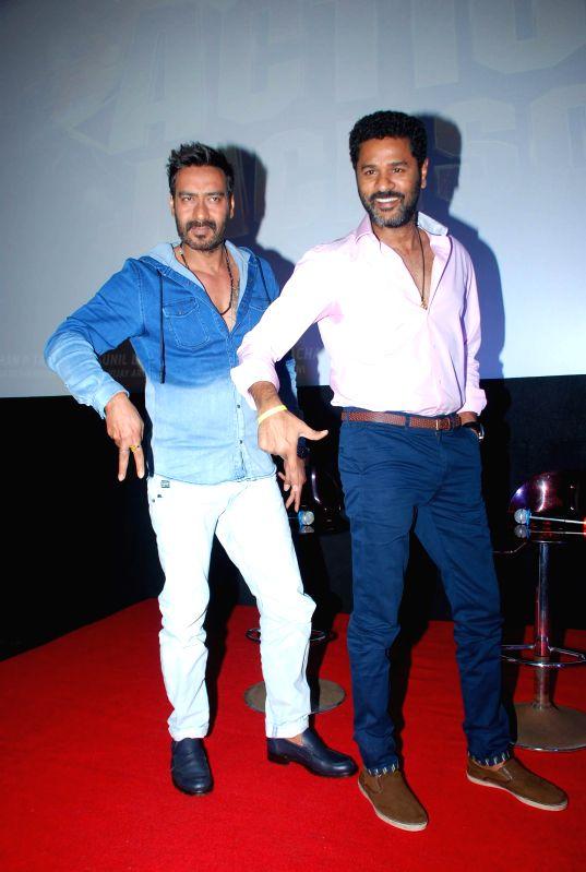 Actor Ajay Devgan and filmmaker Prabhudeva during the song launch of film Action Jackson, in Mumbai on Nov 25, 2014. - Ajay Devgan