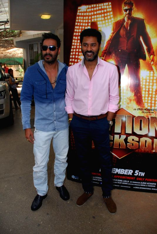 Actor Ajay Devgan and filmmaker Prabhudeva during the song launch of film Action Jackson, in Mumbai on Nov 25, 2014. - Ajay Devgan