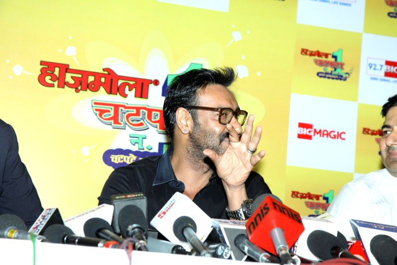 Actor Ajay Devgan during the 92.7 BIG FM and Hajmola Chatpata No 1. Season 2 grand finale press conference of comic talent hunt show in Mumbai on Feb 25, 2015. - Ajay Devgan