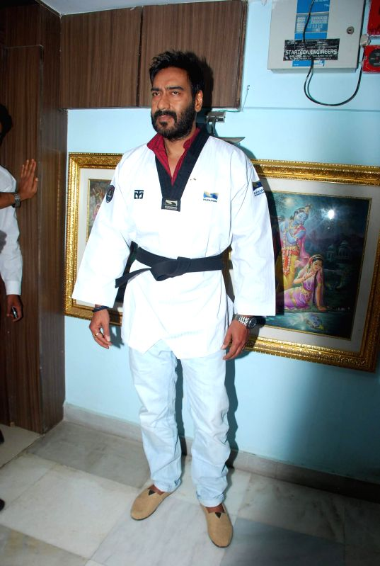 Actor Ajay Devgan during the felicitation by Grandmaster Hwang  by Taekwondo Masters from Korea (Kukkiwon) in Mumbai on Nov. 22, 2014.