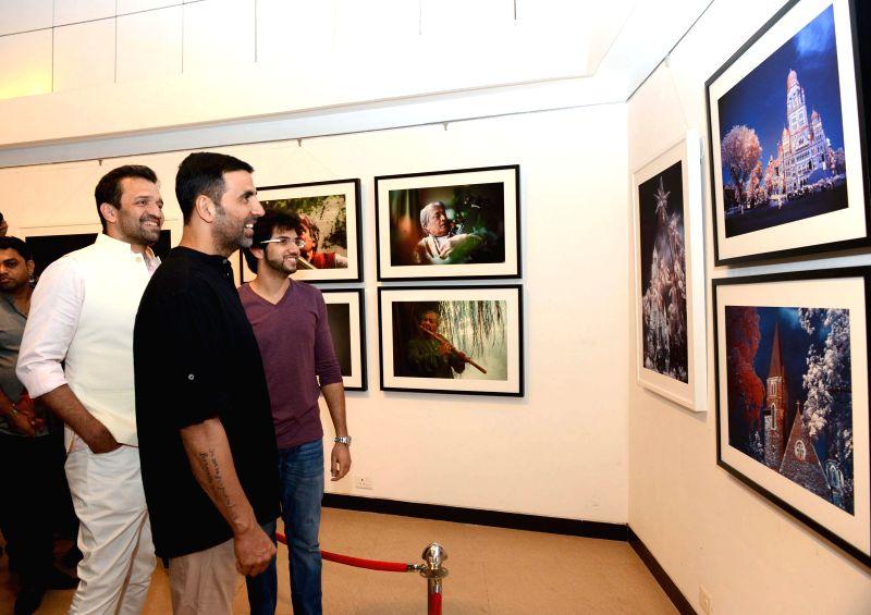 Actor Akshay Kumar at the photography exhibition of Shiv Sena Chief Uddhav Thackeray, organised to raise funds for drought affected farmers, in Mumbai, on Jan 10, 2015. Also seen Yuva Sena ... - Akshay Kumar