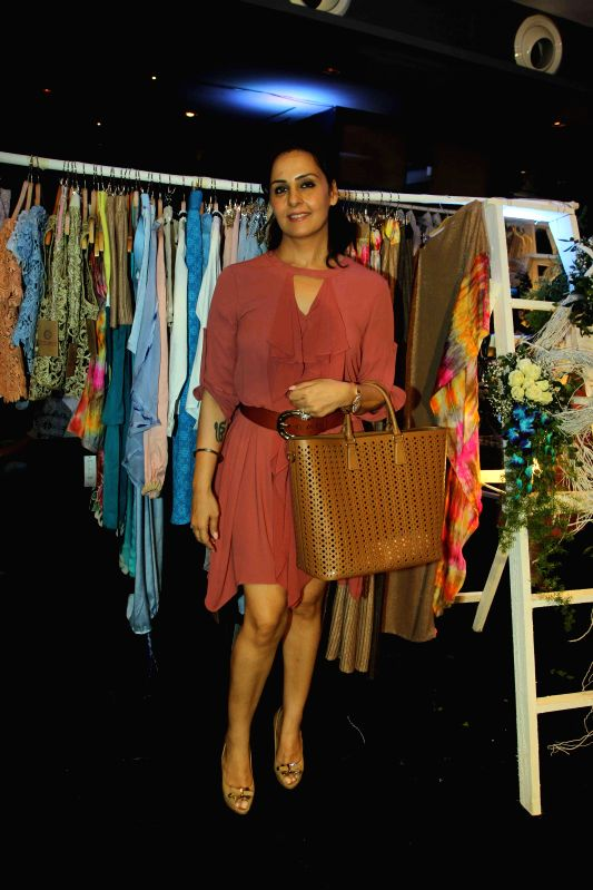 Actor Akshay Kumar`s sister Alka Bhatia during the preview of summer/resort 2015 collection by fashion designer Maheka Mirpuri, in Mumbai on April 9, 2015. - Akshay Kumar