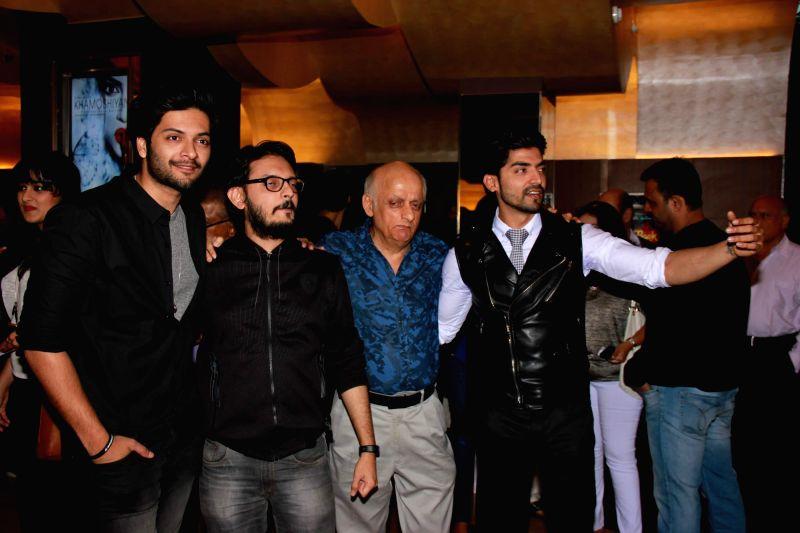Actor Ali Fazal, filmmaker Vishesh Bhatt, filmmaker Mukesh Bhatt and actor Gurmeet Choudhary during screening of the film Khamoshiyan in Mumbai on January 29, 2015. - Ali Fazal and Gurmeet Choudhary