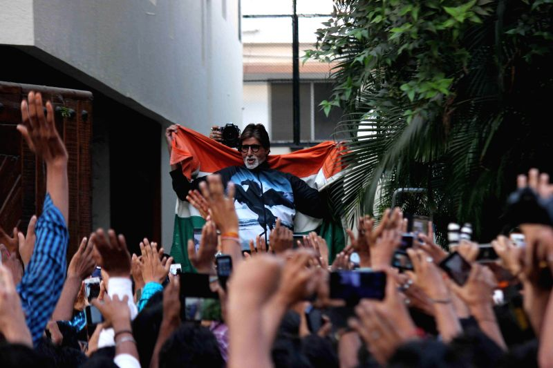 Actor Amitabh Bachchan along with Indian fans celebrate after winning ICC World Cup Pool B match played between India and Pakistan, at the Adelaide Oval cricket stadium, Australia, in Mumbai .