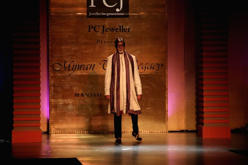 Actor Amitabh Bachchan during Manish Malhotra's fashion show in Mumbai, on April 4, 2015, held to support actor Shabana Azmi`s cause of the Mijwan village in Uttar Pradesh that her father ... - Amitabh Bachchan and Manish Malhotra