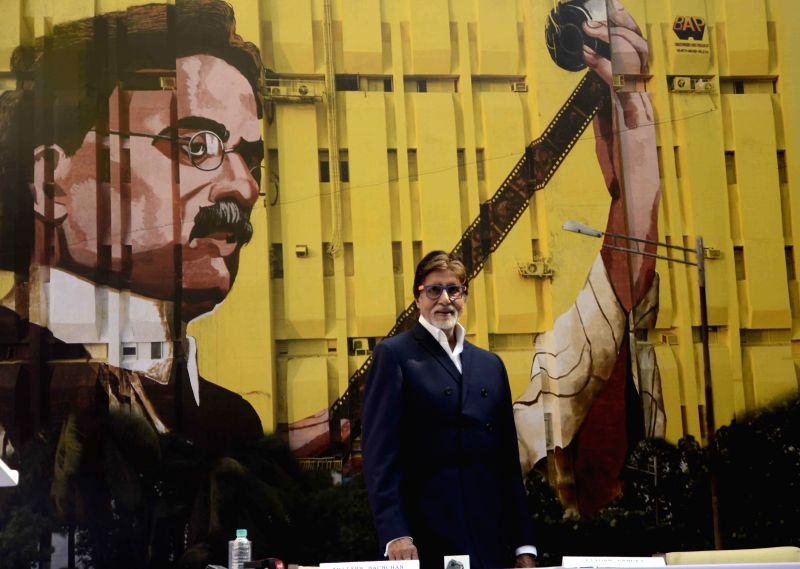 Actor Amitabh Bachchan unveils a 120 x 150 feet painting of the father of Indian cinema Dadasaheb Phalke, at Bandra in Mumbai on Dec 11, 2014.