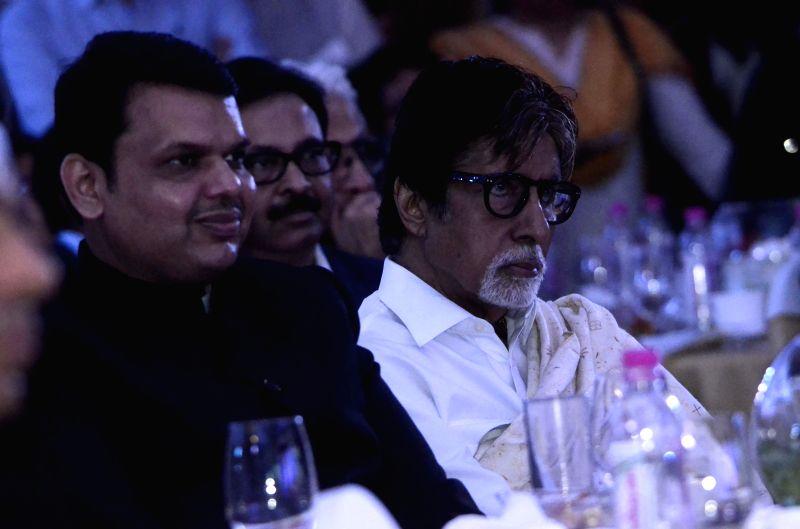 Actor Amitabh Bachchan with Maharashtra Chief Minister Devendra Fadnavis at the inauguration of `Mumbai Next` conclave in Mumbai, on Feb 6, 2015. - Amitabh Bachchan