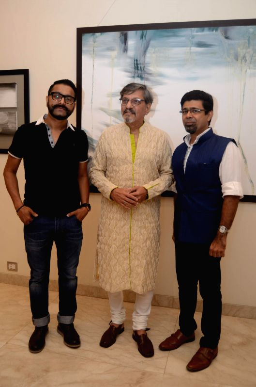 Actor Amol Palekar with artists Sunil Padwal during his painting exhibition, in Mumbai on Nov 25, 2014.