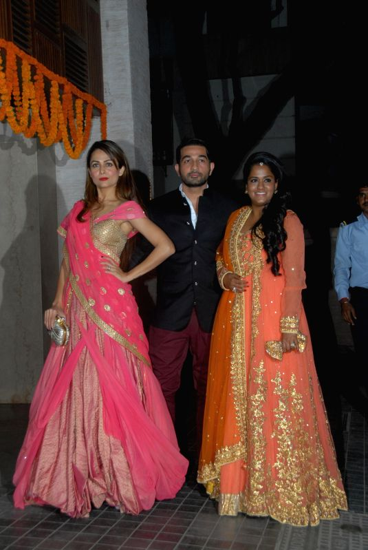 Actor Amrita Arora along with her husband Shakeel Ladak and Arpita Khan during the wedding party of Soha Ali Khan and Kunal Kemu in Mumbai on Jan 25, 2015. - Amrita Arora and Arpita Khan