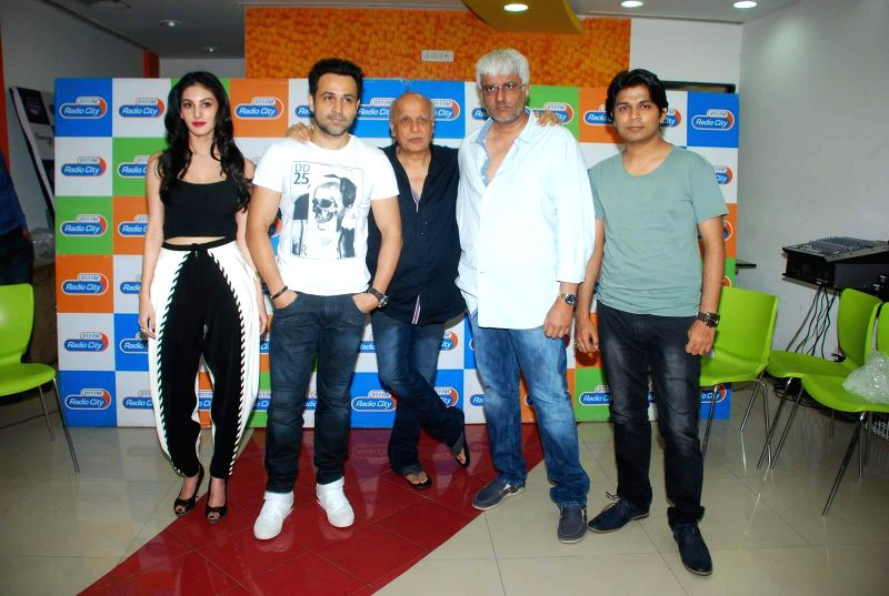 Actor Amyra Dastur, Emran Hashmi, Filmmakers Mahesh Bhatt, Vikram Bhatt and Bollywood singer Ankit Tiwari during the music launch of film Mr. X at Radio City in Mumbai, on March 13, 2015. - Amyra Dastur, Mahesh Bhatt, Vikram Bhatt, Bollywood and Emran Hashmi
