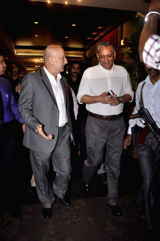 Actor Anupam Kher and Mumbai Police Commissioner Rakesh Maria during the special screening of film Baby in Mumbai on 20th Jan 2015 - Anupam Kher