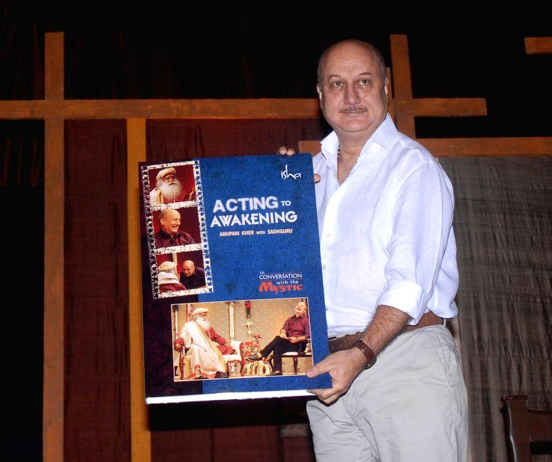 Actor Anupam Kher during the DVD launch of Sadhguru Jaggi Vasudev, Acting 2 Awakening in Mumbai on Jan 11, 2015. - Anupam Kher