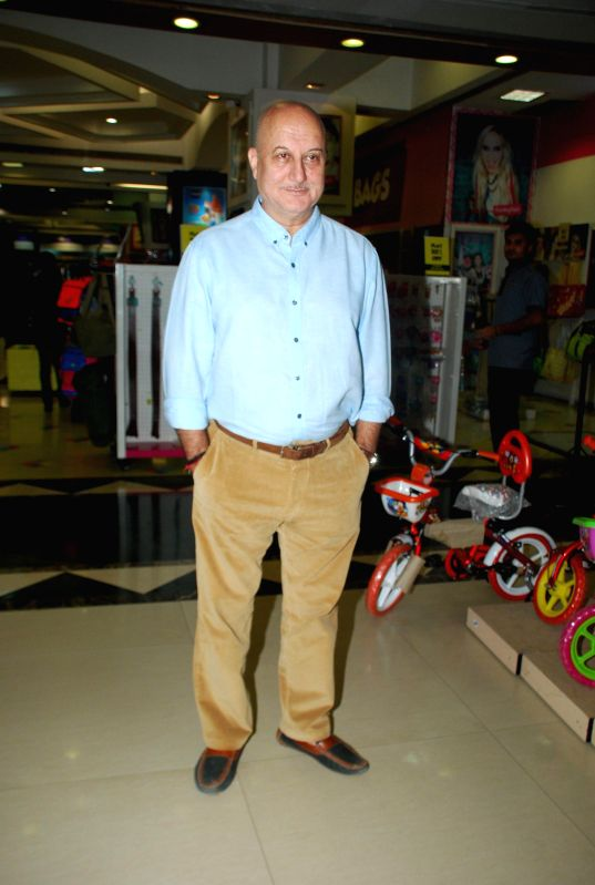 Actor Anupam Kher during the launch of author Gajra Kottary book Once Upon a Star in Mumbai, on Dec. 16, 2014. - Anupam Kher