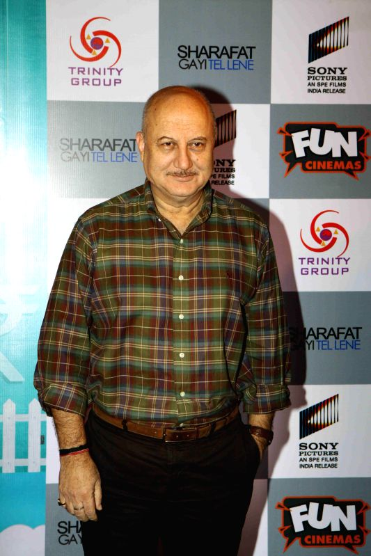 "Actor Anupam Kher during the premiere of film ""Sharafat Gayi Tel Lene"" in Mumbai, on Jan. 15, 2015. - Anupam Kher"