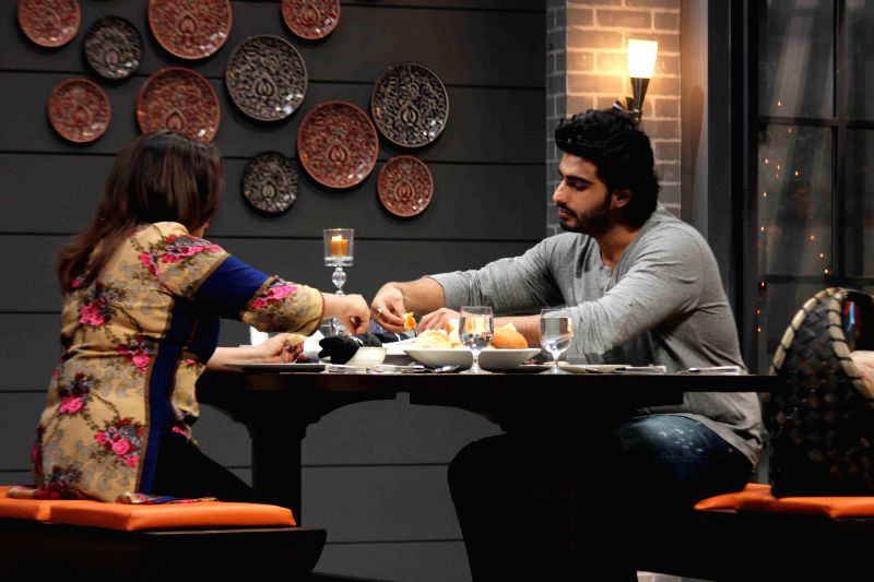 Actor Arjun Kapoor during the Color TV new cookery shows Farah Ki Daawat with host Farah Khan in Mumbai on March 4, 2015. - Farah Khan