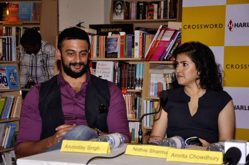 Actor Arunoday Singh and author Nidhie Sharma during the launch of book Dancing with Demon in Mumbai, on Nov 18, 2014. - Arunoday Singh and Nidhie Sharma