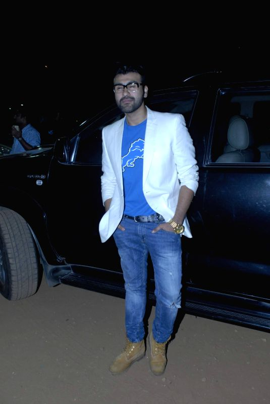 Actor Arya Babbar posing for camera during his book launch.
