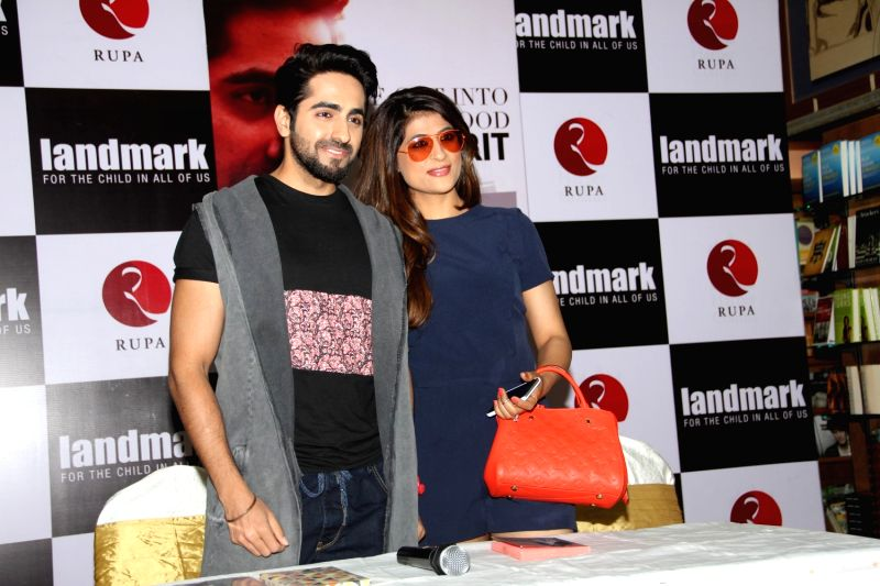 Actor Ayushmann Khurrana, with his wife Tahira Kashyap during the launch of their book 'Cracking the Code' in Mumbai, April 3, 2015. - Tahira Kashyap